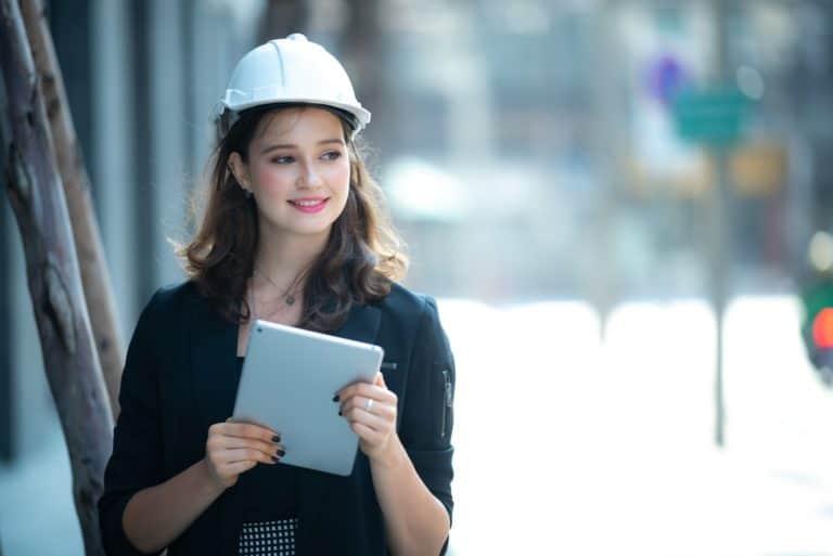 beautiful woman civil engineer close up portrait on field site